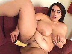 Lonely fat vixen dildofucks on sofa