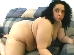 Giant obese lady caresses her pussy