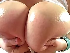 Busty plumper caresses huge boobs