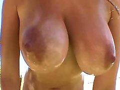 Redhead plays w big tits in nature