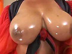Brazilian fatty presents oiled tits