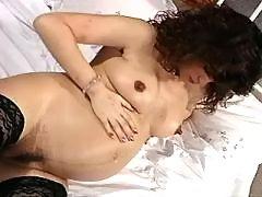 Pregnant mature masturbates in bed