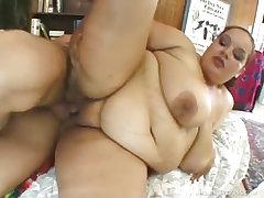 Redhead fatty peels her pussy lips apart