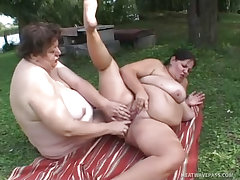 Hefty lesbos fucking by the river