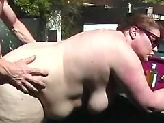 Obese babe fucks on table
